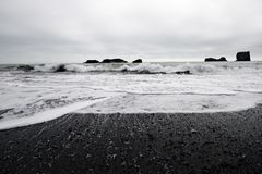 Volcanic beach. Depressive atmosphere - volcanic beach in cloudy weather, Iceland Stock Photography