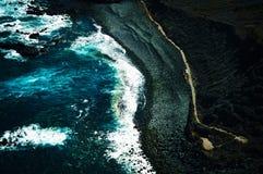 Volcanic beach and the Atlantic ocean. Volcanic beach on the island of Tenerife at the Atlantic ocean stock photos