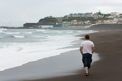 Volcanic beach atlantic ocean man walking Royalty Free Stock Photography