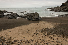 Volcanic beach in Poley Bay, Coromandel Peninsula Royalty Free Stock Photos