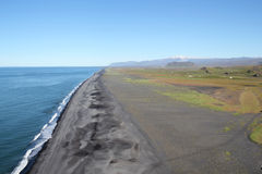 Volcanic beach at South Iceland. Black volcanic beach at Atlantic coast near cape Dyrholaey, Iceland stock images