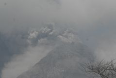 VOLCANIC BLESSING. Volcano Merapi area at the time of the 2010 eruption of the Volcano at Java, Indonesia. Frequent eruptions from one of the most active volcano stock images