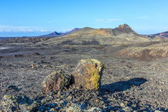 Volcanic bomb in front of volcano Montana Colorada in Lanzarote, Stock Image