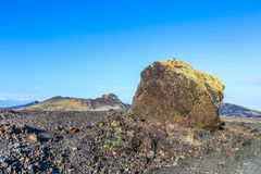 Volcanic bomb in front of volcano Montana Colorada in Lanzarote, Royalty Free Stock Photos