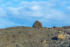 Volcanic bomb in front of volcano Montana Colorada in Lanzarote, Royalty Free Stock Photo