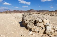 Volcanic bomb in geological Timna Park. Geological Timna Park is located 25 km north of Eilat ans combines ancient history, unique geology and variety of sport Royalty Free Stock Photos