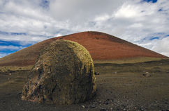 Volcanic bomb on Lanzarote island. Volcanic bomb near volcano Montana Colorada - Lanzarote - Canary islands - Spain Stock Image