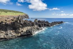 The volcanic cliff near the Ana Kai Tangata bay stock images