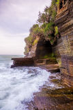 Volcanic Cliff With Sea Waves Royalty Free Stock Photography