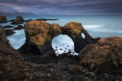 Volcanic cliffs and basalt rocks in Arnarstapi royalty free stock photography