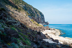 Volcanic coast in Cala Gonone. Volcanin coast close to Biddiriscottai cave in Cala Gonone, Sardinia, Italy Royalty Free Stock Images