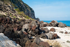 Volcanic coast in Cala Gonone. Volcanin coast close to Biddiriscottai cave in Cala Gonone, Sardinia, Italy Royalty Free Stock Image