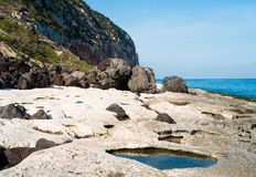 Volcanic coast in Cala Gonone Stock Image