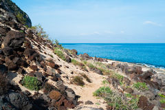 Volcanic coast in Cala Gonone Stock Photo