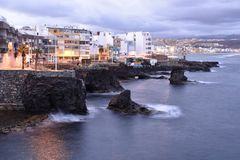 Volcanic coast with modern houses Gran Canaria Spain stock photos