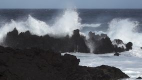 Volcanic coast, waves breaking in super slow motion stock video