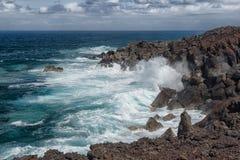 Volcanic coastline ocean waves, Lanzarote, Spain Stock Photos