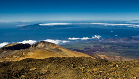 Volcanic crater. Formation and island at the horizon Stock Photos