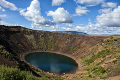 Volcanic crater Kerid with blue lake inside, at sunny day with beautiful sky, Iceland Royalty Free Stock Images