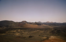 Volcanic crater and panorama, Lanzarote. Timanfaya National Park, panorama and volcanic crater in the lava desert Royalty Free Stock Images