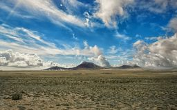 Volcanic crater in the Timanfaya National Park under a blue sky with clouds. Lanzarote, Canary Islands, Spain. stock photo