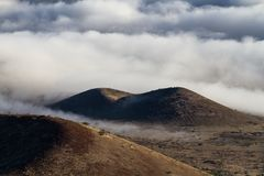 Craters and Clouds. Volcanic craters in the cloud line Royalty Free Stock Image