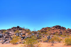 Volcanic desert rock Stock Photos