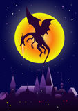 Volcanic dragon. Fire-breathing dragon flying over the city on the background of the Moon Stock Photos