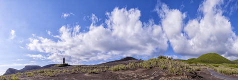 Volcanic dust and road on background of mountains and the lighthouse in the Azores Stock Image