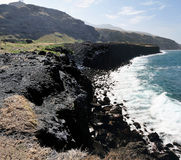 Volcanic Edge. Fierce waves hit the high coast cliff in Salinas, on the town of Sao Jorge, Fogo, cabo Verde stock images