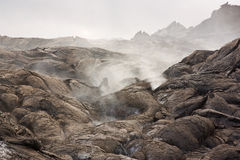 Volcanic gases and a lava flow Stock Images