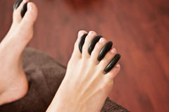Hot rocks massage, feet Stock Photography
