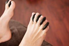 Hot rocks massage, feet Stock Photography