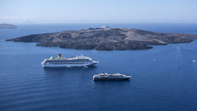 Volcanic island and  cruise ships Stock Image