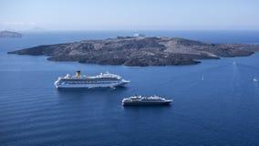 Volcanic island and  cruise ships Stock Image