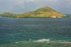 Volcanic island in Komodo Naional Park, Flores Sea, Nusa Tenggar. A, Indonesia. The park comprises a coastal section of western Flores and 29 islands and the Royalty Free Stock Photography