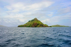 Volcanic island in Komodo Naional Park, Flores Sea, Nusa Tenggar. A, Indonesia. The park comprises a coastal section of western Flores and 29 islands and the Stock Photography