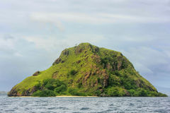 Volcanic island in Komodo Naional Park, Flores Sea, Nusa Tenggar. A, Indonesia. The park comprises a coastal section of western Flores and 29 islands and the Stock Image