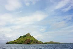 Volcanic island in Komodo Naional Park, Flores Sea, Nusa Tenggar. A, Indonesia. The park comprises a coastal section of western Flores and 29 islands and the Royalty Free Stock Photos