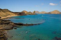 Volcanic island in ocean Stock Photo