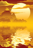 Volcanic island. Sunset over tropical island and erupting volcano Royalty Free Stock Photo