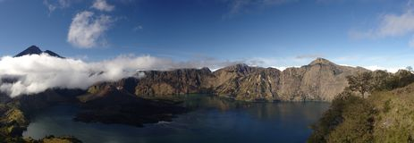 The volcanic lake. Of the Rinjani Mount, in Lombok, Indonesia. We can see the baby volcano under the cloud. It is here since the 1963 explosion, which caused Royalty Free Stock Photo