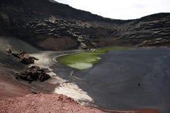 Volcanic lake ii. A volcanic lake near the island coast stock photography