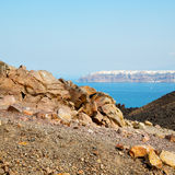 Volcanic land in europe santorini greece sky and mediterranean s Royalty Free Stock Images