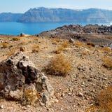 Volcanic land in europe santorini greece sky and mediterranean s Stock Photo