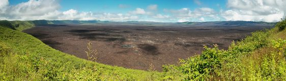 Volcanic landscape of the big crater of Sierra negra volcano in Isabela island Stock Photo