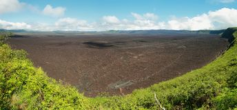 Volcanic landscape of the big crater of Sierra negra volcano in Isabela island Stock Images