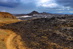 Volcanic landscape in Iceland. Volcanic landscape with mount Krafla in the back in Iceland Royalty Free Stock Images
