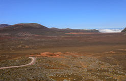Volcanic landscape of Plaine des Sables with a road, Reunion. Island Royalty Free Stock Images