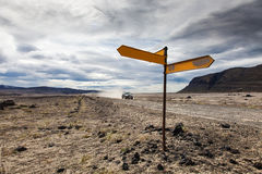 Volcanic landscape - roadsign and vehicle Stock Image